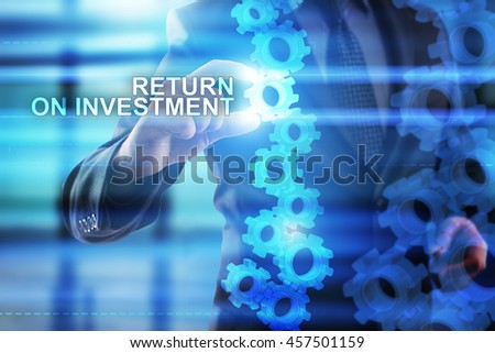 Businessman is selecting Return on investment on the virtual screen.