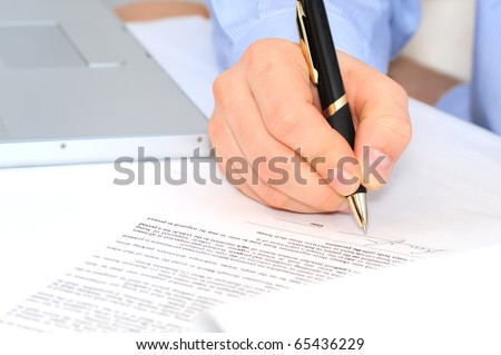 Businessman is signing a contract - stock photo