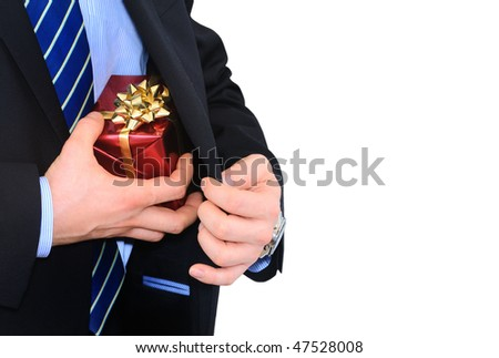 Businessman is taking gift from under his coat - stock photo