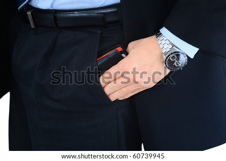 Businessman is taking his wallet out of the pocket - stock photo