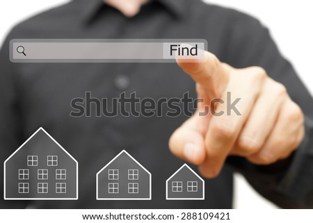 businessman is using internet search bar to  find real estate - stock photo