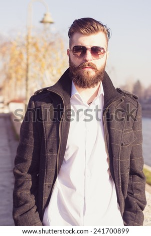 Businessman is walking to work - stock photo