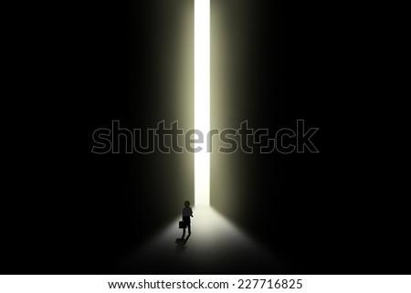 Businessman is walking toward the opportunity door - stock photo
