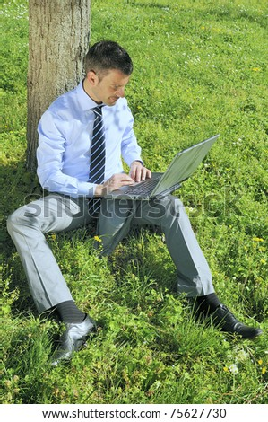 businessman is working in a natural background - stock photo