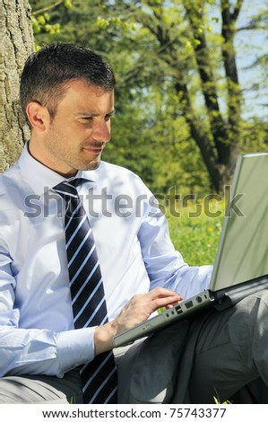 businessman is working in a natural background