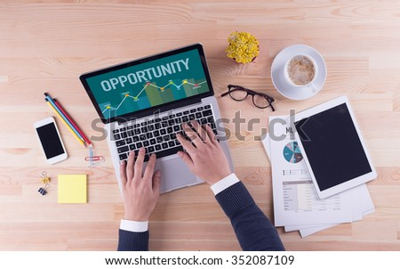 Businessman is working on desk - OPPORTUNITY - stock photo