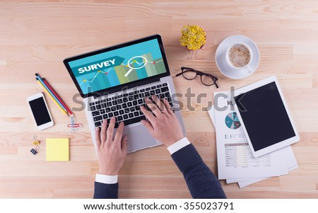 Businessman is working on desk - SURVEY - stock photo