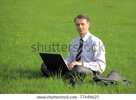 businessman is working outdoors - stock photo