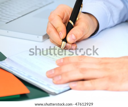 Businessman is writing a check - stock photo