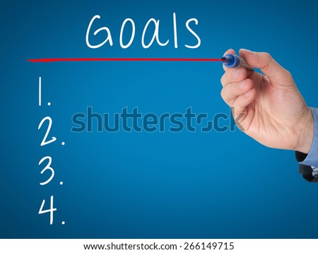 Businessman is writing goals list,  planning on whiteboard. Isolated on blue. Stock Image - stock photo