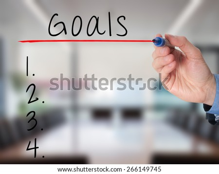 Businessman is writing goals list,  planning on whiteboard. Isolated on office. Stock Image - stock photo