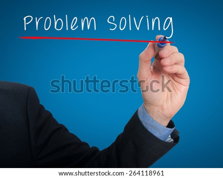 Businessman is writing Problem Solving on the transparent board. Isolated on blue background. Stock Photo - stock photo