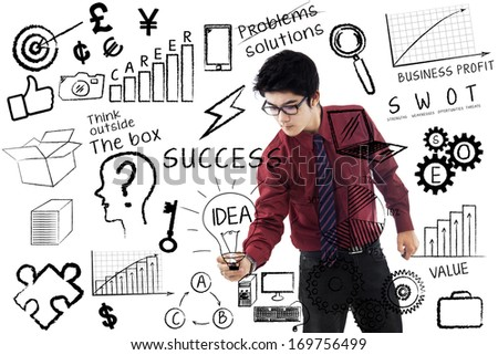 Businessman is writing success concept on transparent whiteboard - stock photo