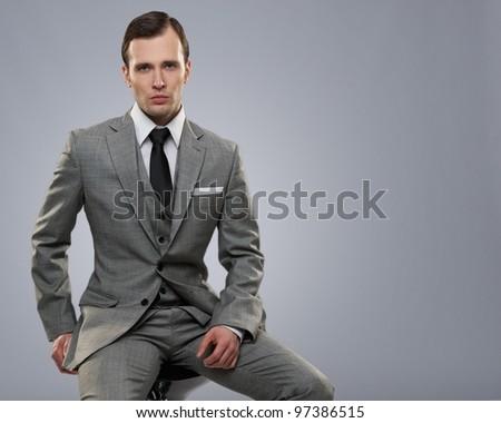 Businessman isolated on grey background. - stock photo