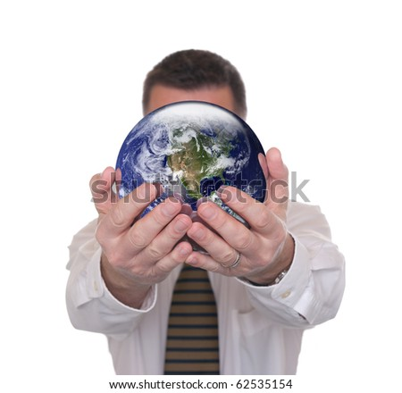 Businessman isolated on white. Globe public domain courtesy http://visibleearth.nasa.gov/  Focus on globe. Concept for ambition and career possibilities. - stock photo