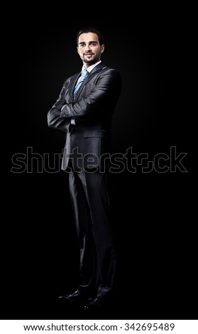 businessman isolated over black background - stock photo