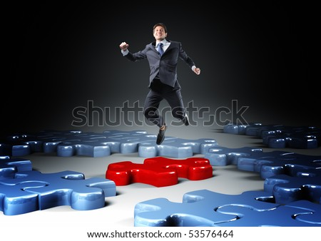 businessman jump over 3d jigsaw  puzzle - stock photo