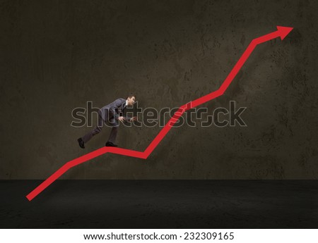 businessman jump over growing chart - stock photo