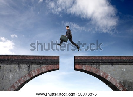 Businessman jumping a gap between two bridge parts - stock photo