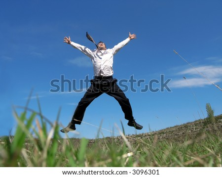 Businessman jumping in the air with success