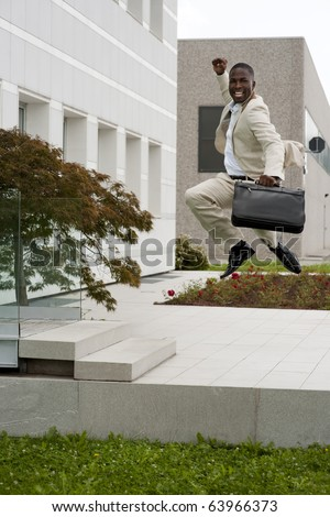 Businessman jumping of happiness outside his office