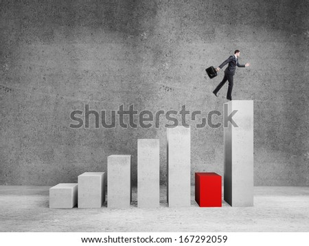 businessman jumping on graph  in room