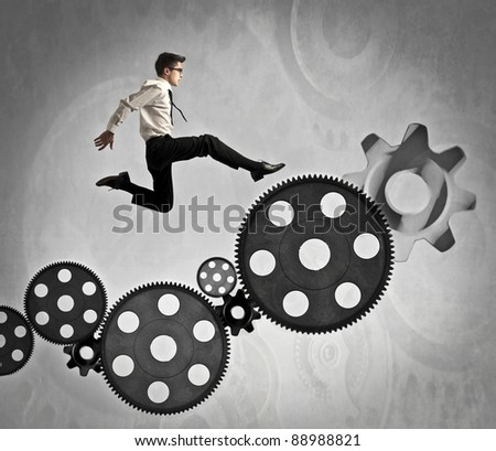 Businessman jumping on some mechanisms - stock photo