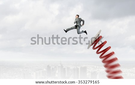 Businessman jumping on springboard as progress concept - stock photo