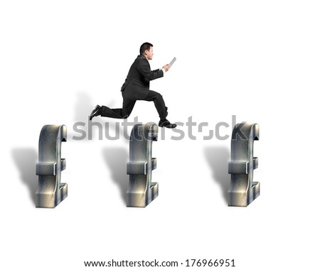 Businessman jumping over 3d pound symbols isolated in white background