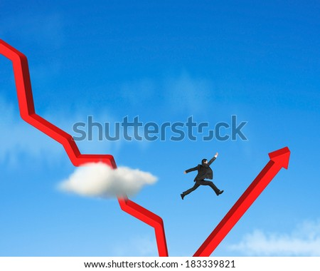 Businessman jumping over gowing down red arrow blue sky - stock photo