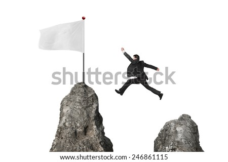 businessman jumping over mountain peak to blank flag isolated on white background - stock photo