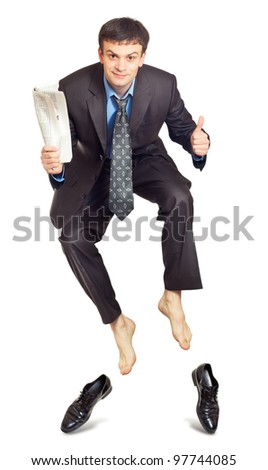 Businessman jumping with newspaper in hand on white