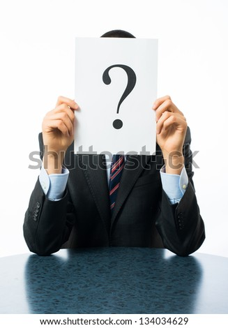 Businessman keeps a question mark - stock photo
