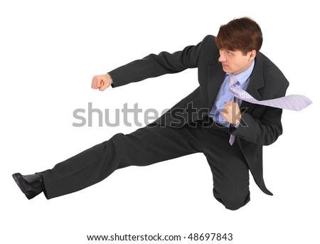 Businessman kicks forward, isolated on a white background - stock photo