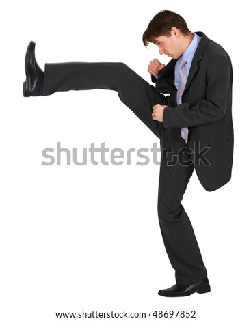 Businessman kicks up, isolated on a white background - stock photo