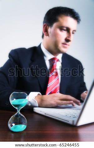 Businessman late night working on laptop - stock photo