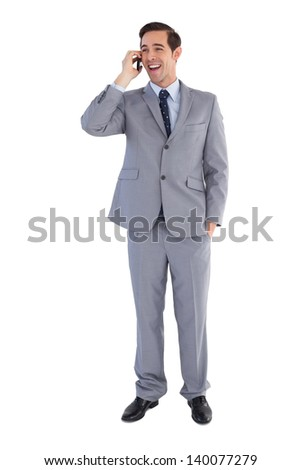 Businessman laughing while he is on the phone on white background - stock photo