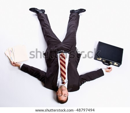 Businessman laying on floor and briefcase - stock photo