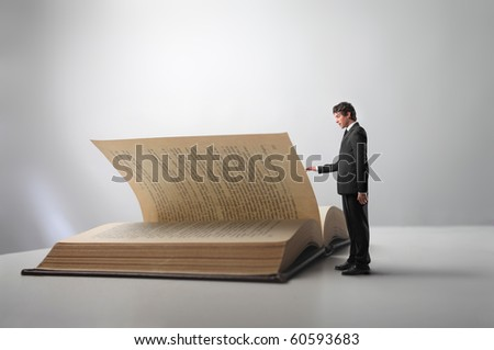 Businessman leafing through a book