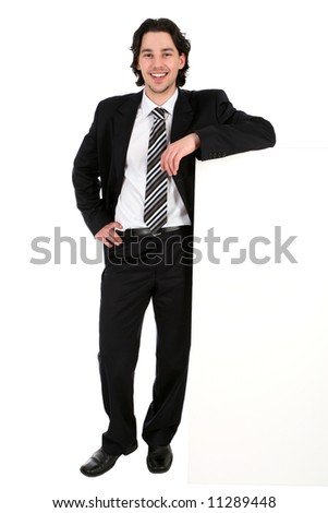 Businessman leaning on a billboard