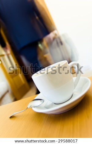 Businessman leaving home after a breakfast. - stock photo