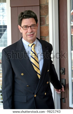 businessman leaving home for work