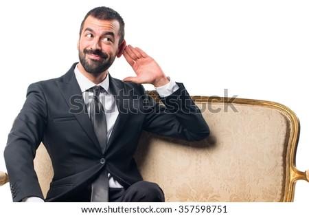 Businessman  listening something - stock photo