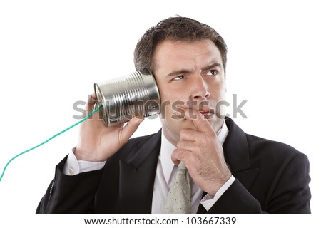 Businessman listening to a conversation from a telephone can - stock photo