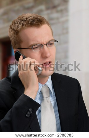 Businessman listening to a customer on his cell phone