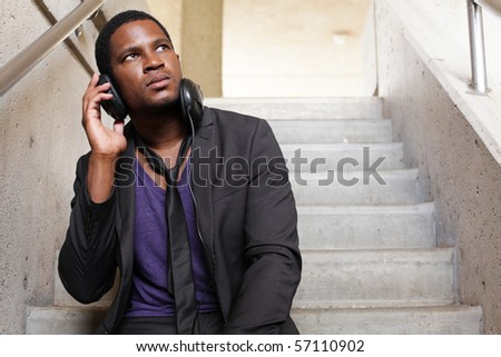 Businessman listening to DJ headphoness - stock photo