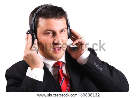 Businessman listening to music and singing, having a break