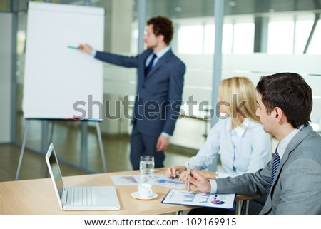 Businessman listening to presentation of a new project at seminar - stock photo