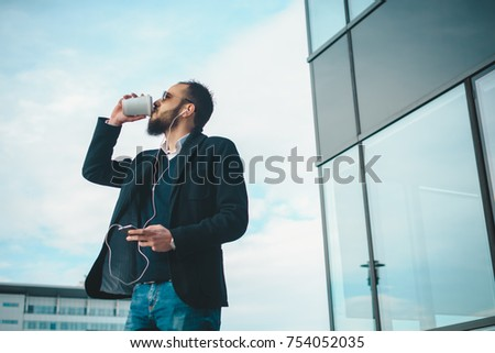 Businessman listening to the music on a coffee break