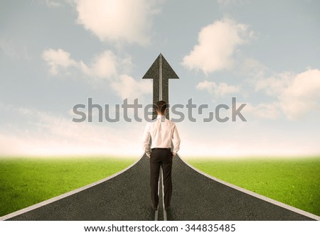 Businessman lokking at 3d road upgoing arrow concept - stock photo